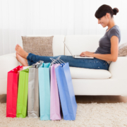 Young Beautiful Woman Sitting On Couch Shopping Online